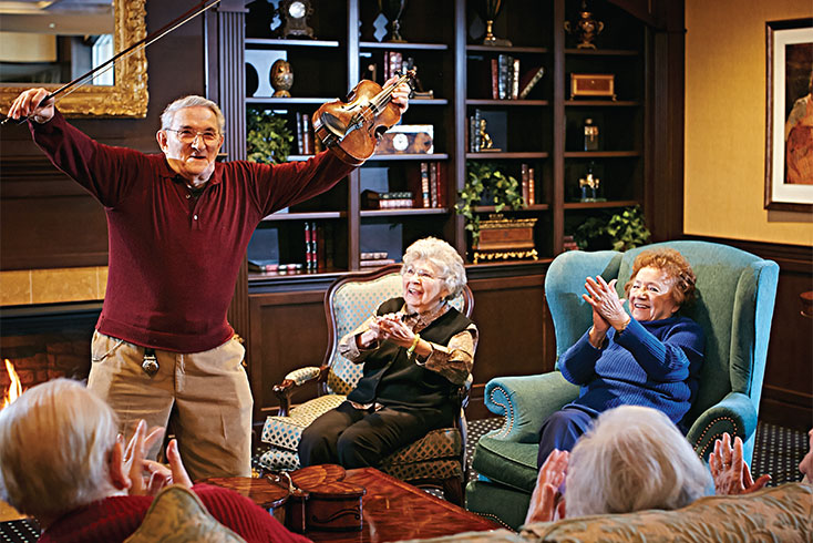 Resident Plays Violin for Senior Friends