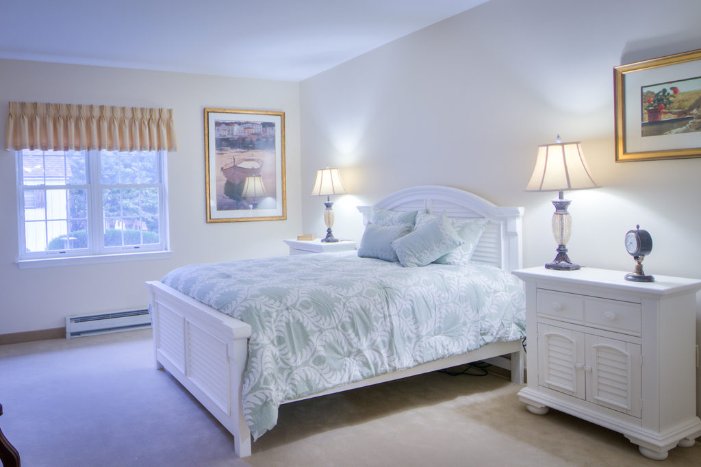 Resident Bedroom with clean furniture and pleasant decor.