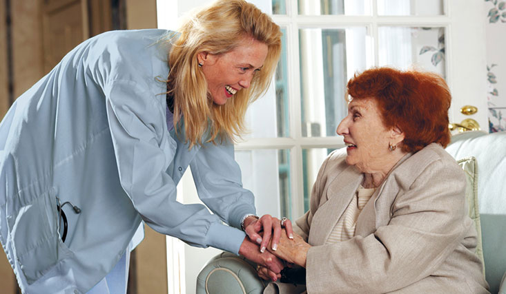 Caregiver holding hands with resident at Brandywine Living