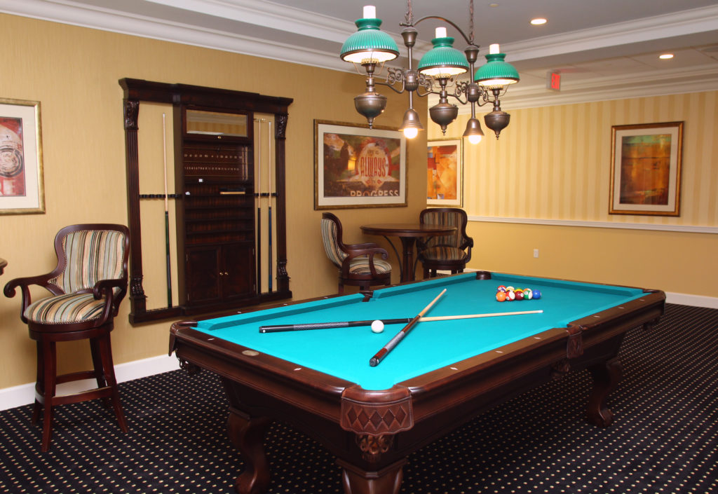 billiards room with a pool table and seating for other activities
