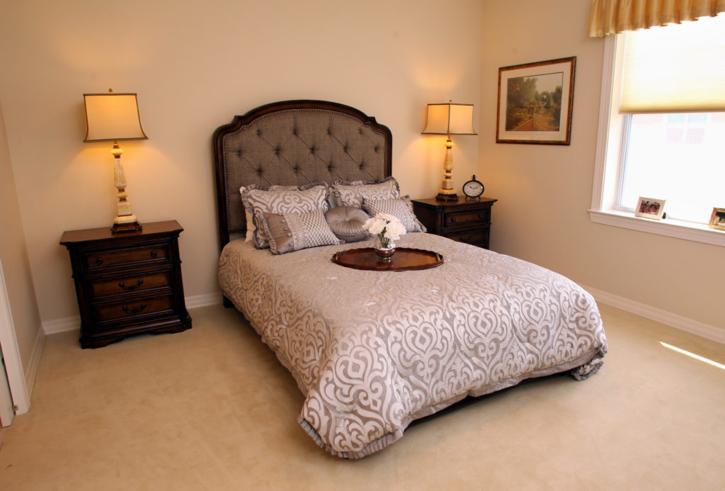 Resident bedroom with a comfortable bed.