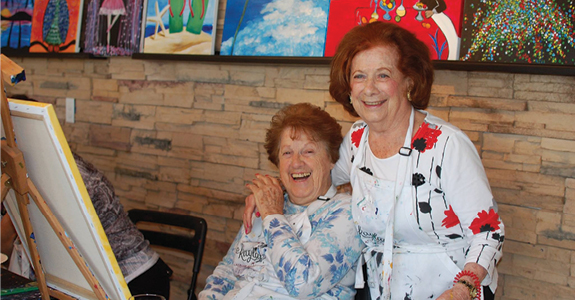 Two Female Seniors Painting