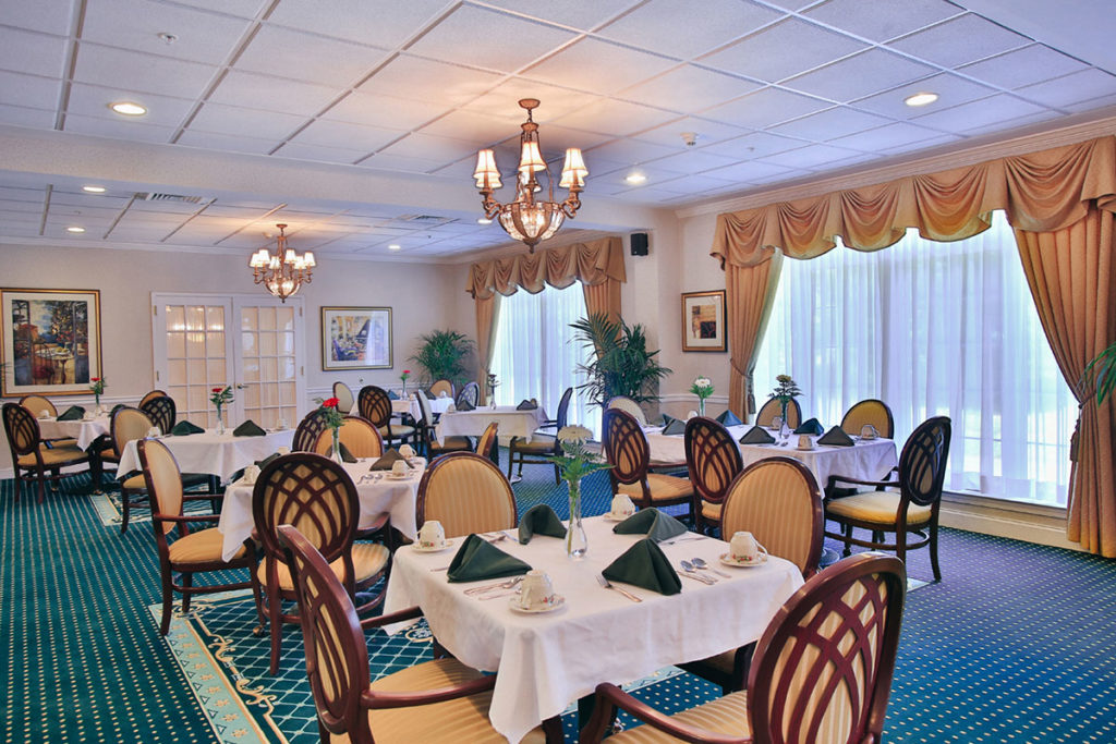 Brandywine Living at Wall - Dining Room with white table cloths and folded napkins