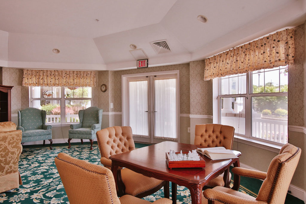 Brandywine Living at Wall - table and chairs with board game