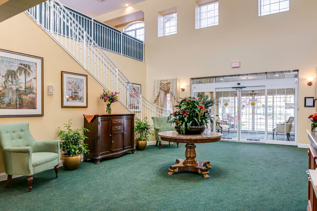 Brandywine Living at Reflections at Colts Neck front lobby with green carpet and flwers