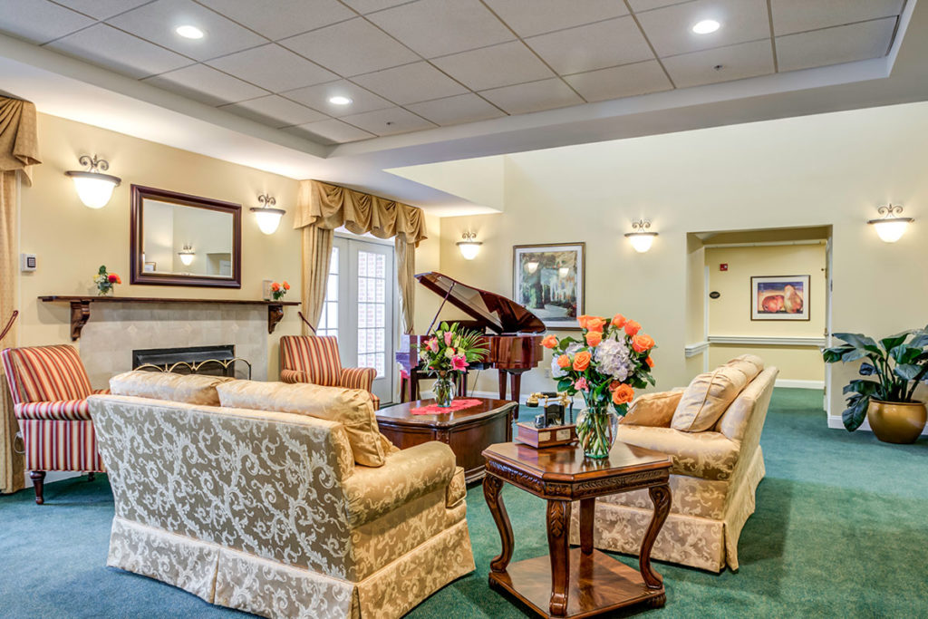 Brandywine Living at Reflections at Colts Neck Music Room with couches and grand piano