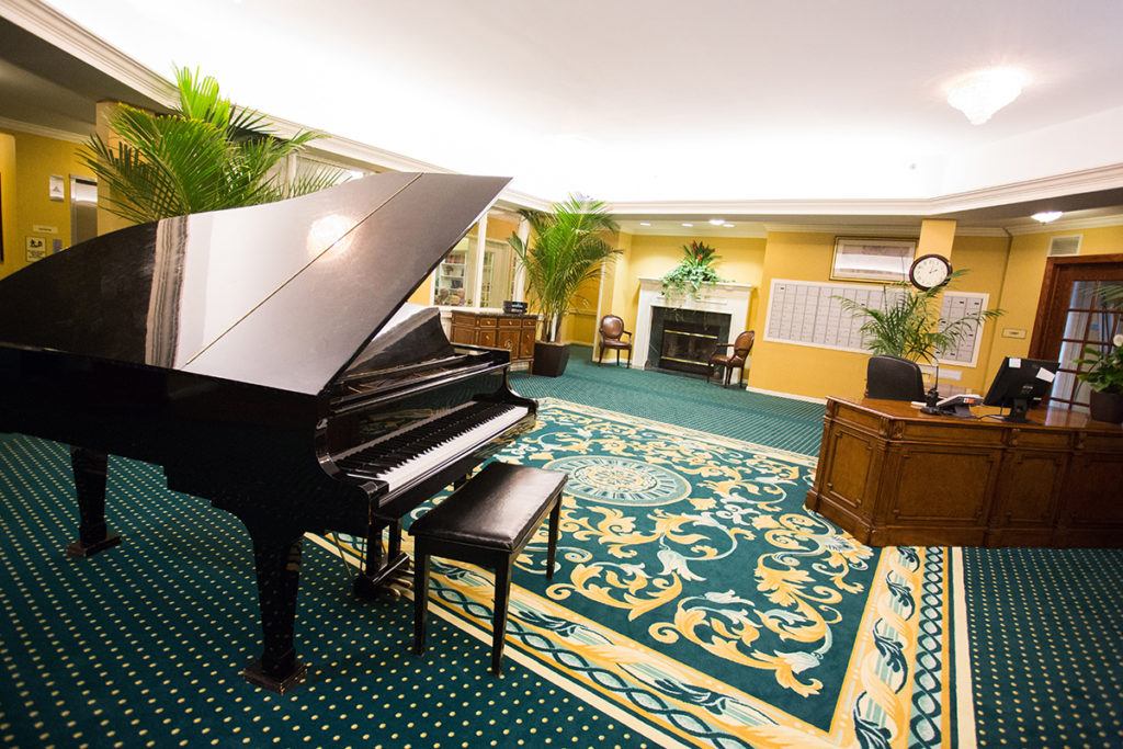 Brandywine Living at The Gables lounge room with grand piano
