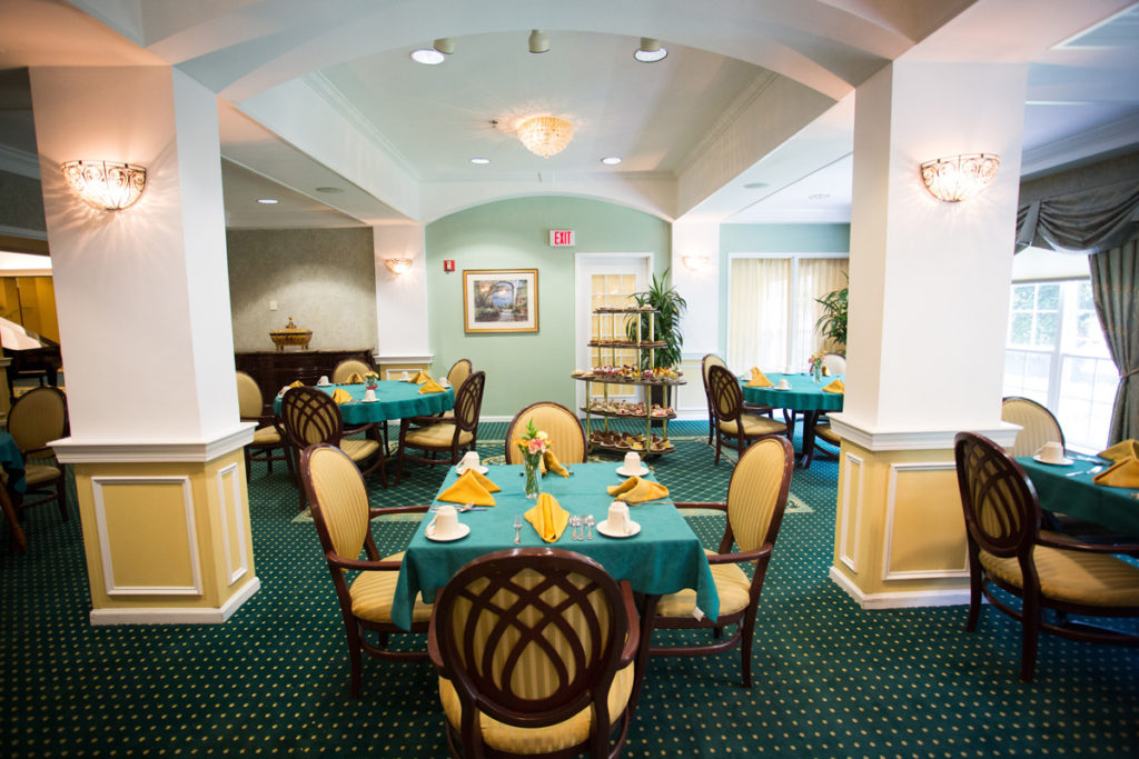 Brandywine Living at The Gables dining room with tables, chairs, table cloths and place settings