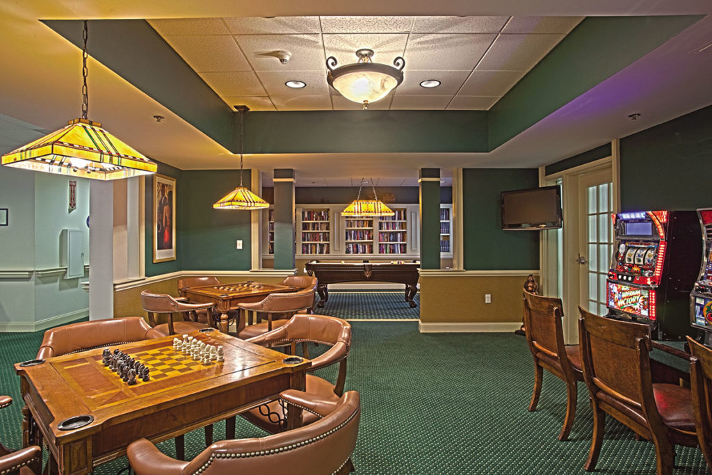 Game room at howell with chess tables, and seating for other activities.