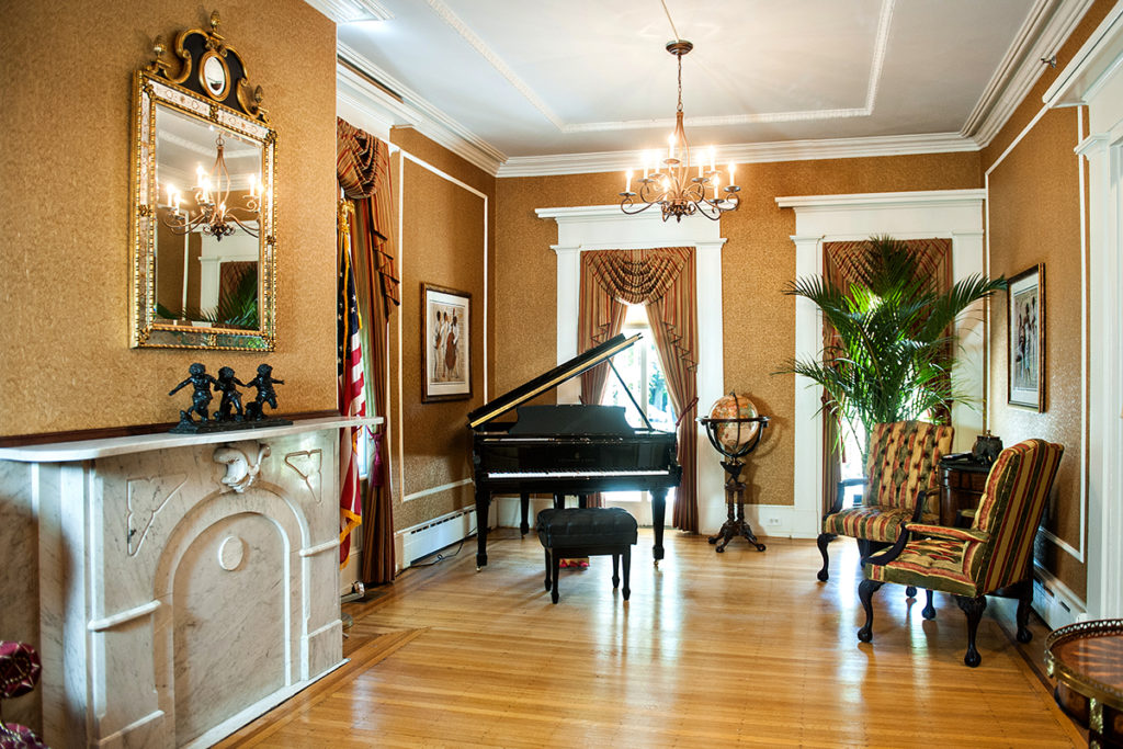 Living room of Brandywine Living in Haddonfield with piano and chairs