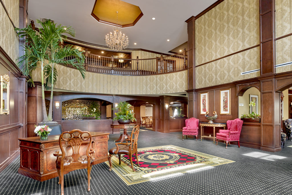 Image of the lobby with a large chandelier.