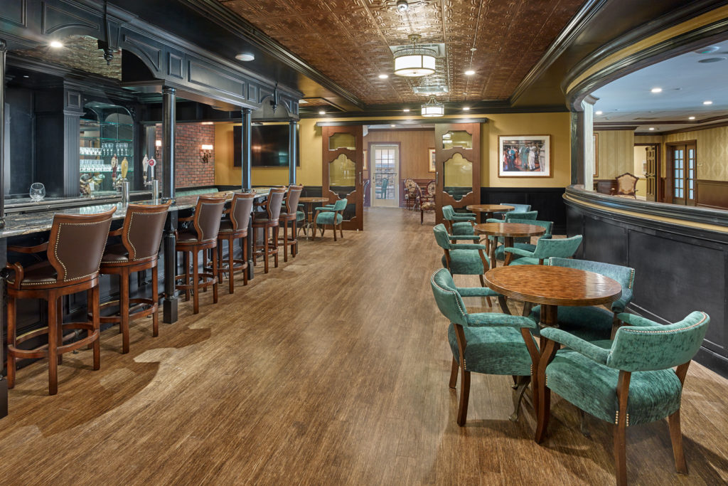 In-house pub with plenty of seating to enjoy a drink at.