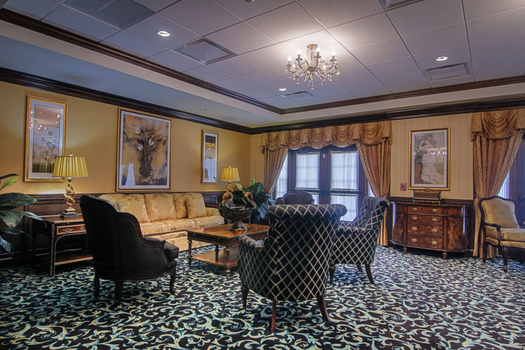 Reflections lounge with nice couches and crown moulding.
