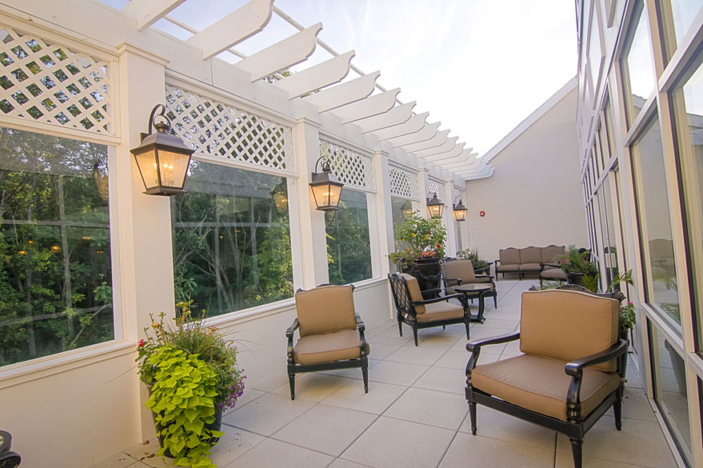 Outdoor seating area with nice views and plenty of seating to enjoy socializing with other residents.