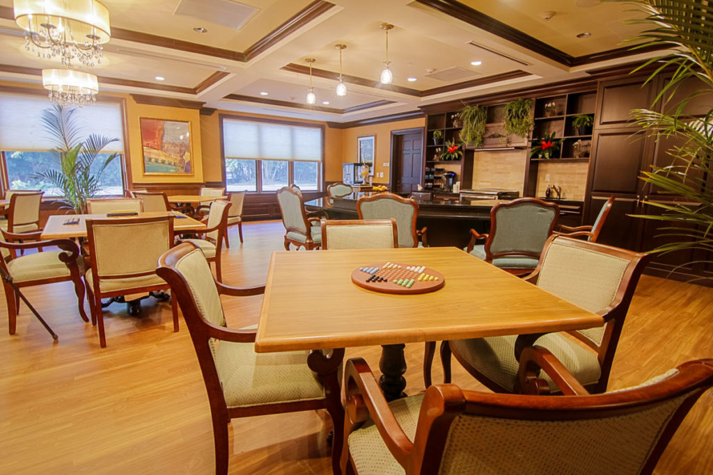 Escapades room with crown molding and plenty of seating for activities.