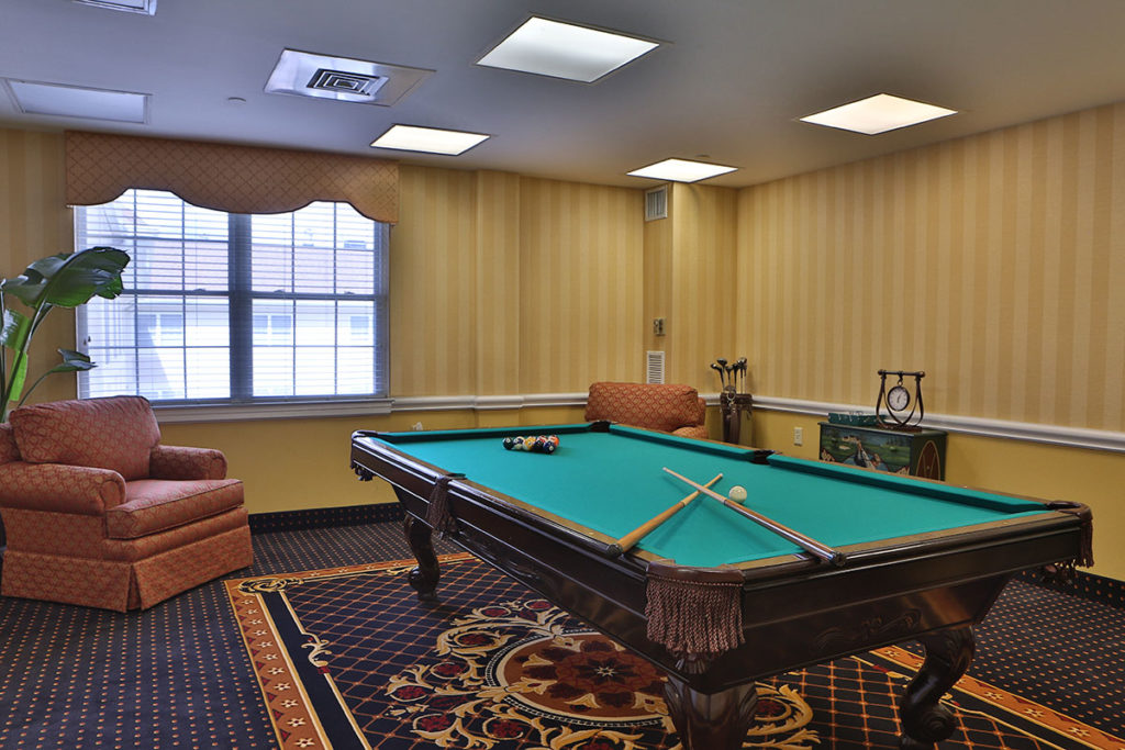 Brandywine Living at Mountain Ridge billiard room with table
