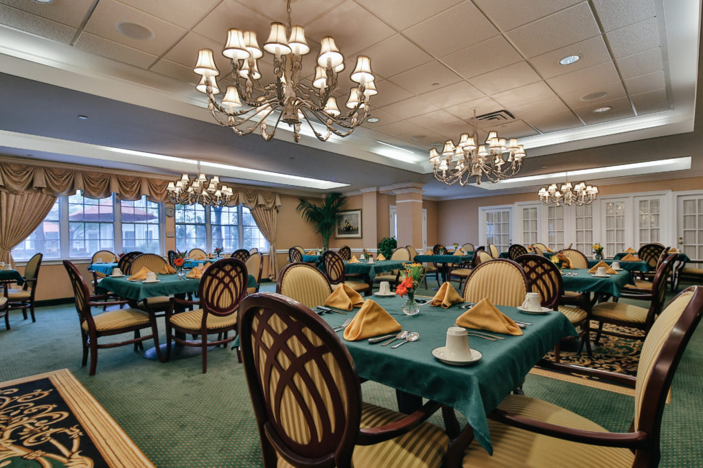 Brandywine LIving at Pennington Dining Room with tables, chairs and tablecloths