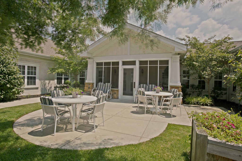 Brandywine Living at Reflections at Brick courtyard with outdoor tables