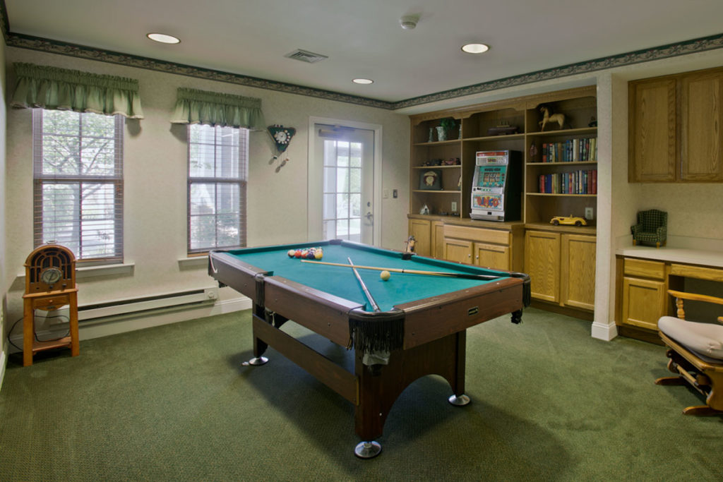 Brandywine Living at Reflections at Brick Game room with pool table