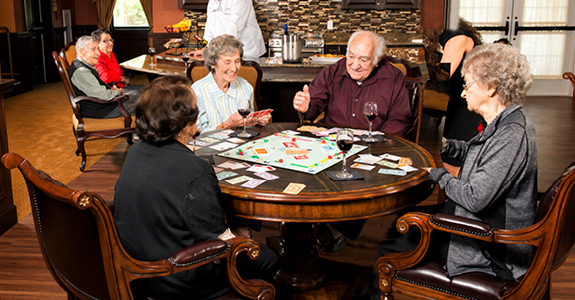 Senior Residents Playing Monopoly in Tap Room