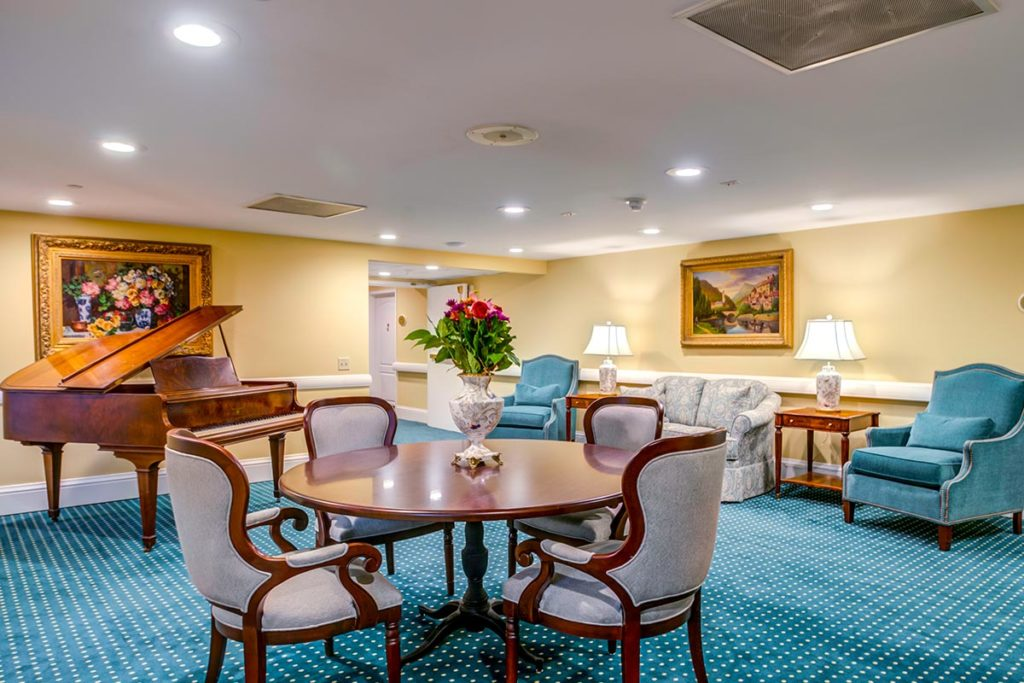 Music room in the savoy with a piano for guests and residents to play.