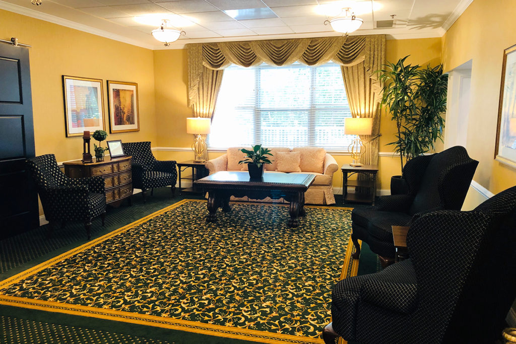 The Sycamore Living Room with arm chairs and couch