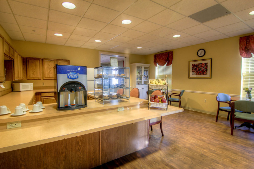 Brandywine Living at Toms River bistro area with self serve coffee machine, pastries and fruit