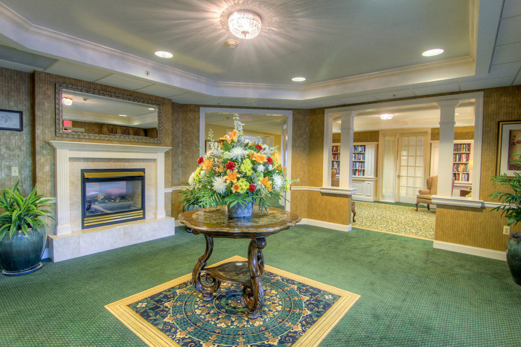 Brandywine Living at Toms River Entryway with beautiful flowers and nice carpet and table