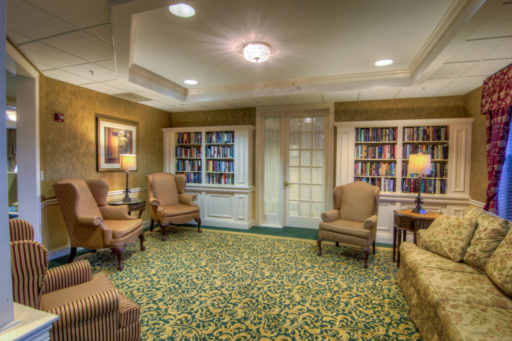 Brandywine Living at Toms River library with comfy armchairs and bookshelves