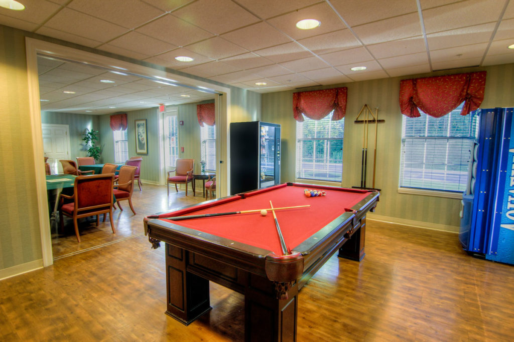 Brandywine Living at Toms River pool room - red upholstered pooltable