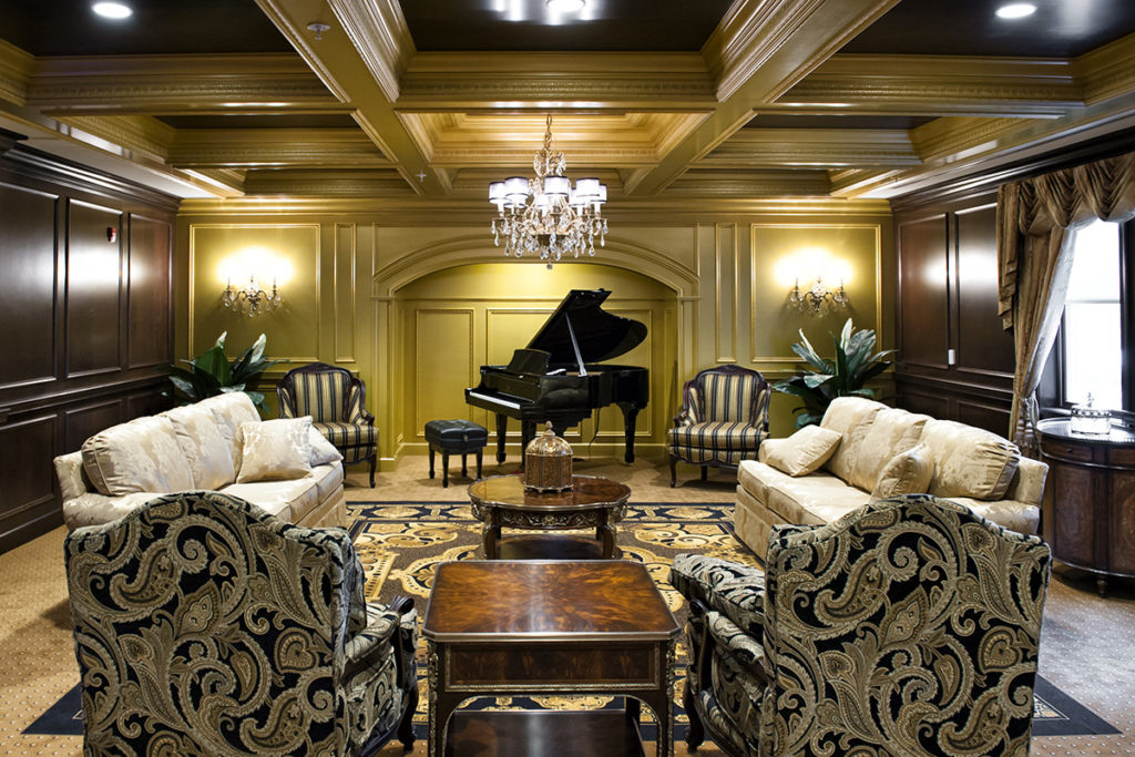 music room with piano in a beautifully decorated hall