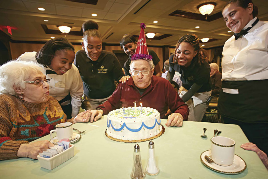 Brandywine Living at Pennington resident blowing out candles on birthday cake