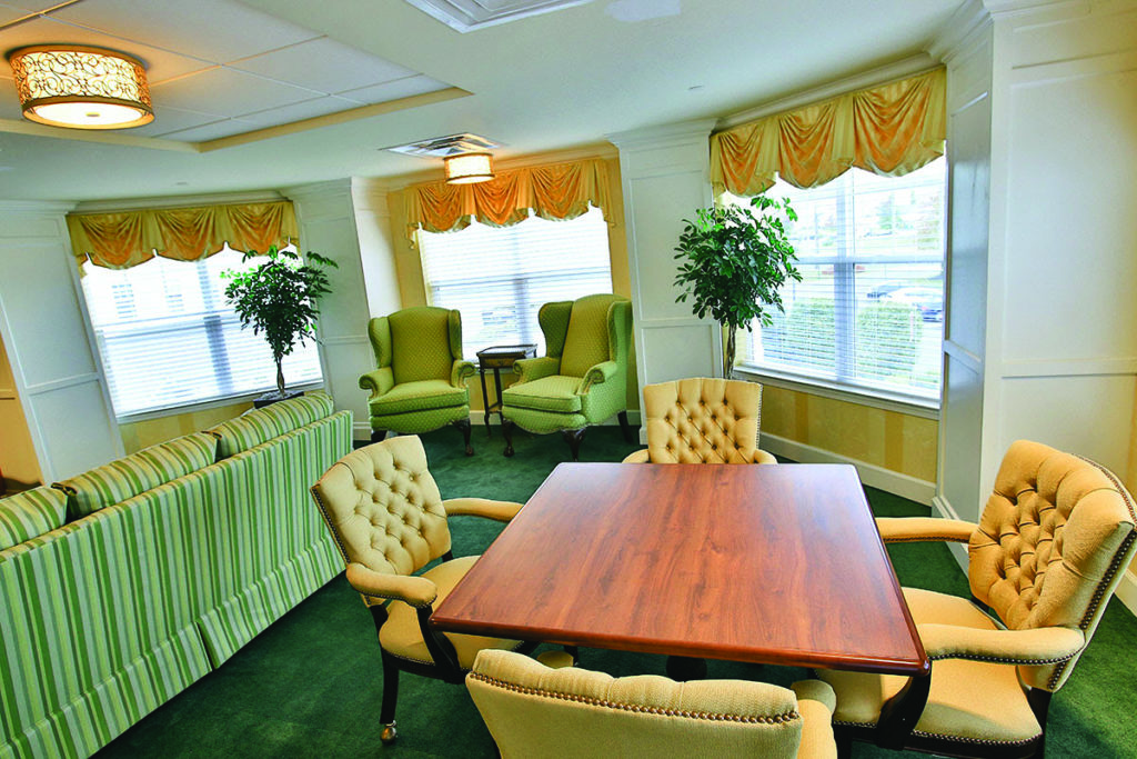 Brandywine Living at Wall - interior shot, table and chairs, green carpet