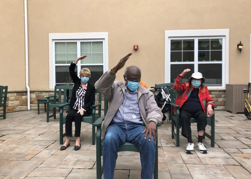 Residents participating in outdoor exercise class