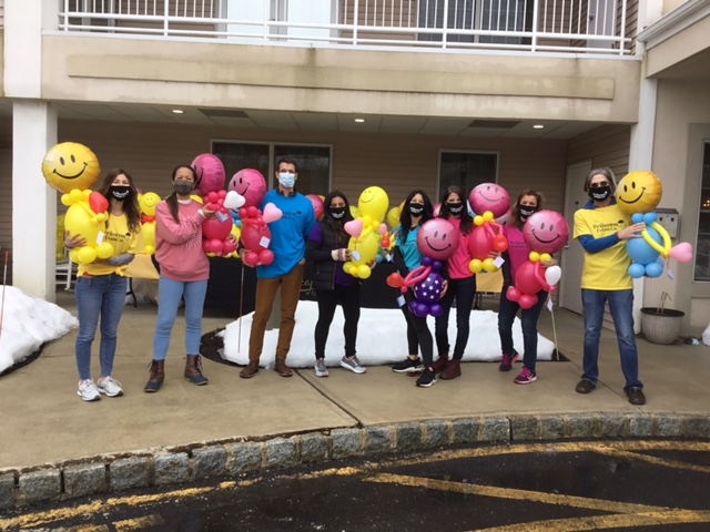 Brandywine Team Members Holding Balloon Buddies