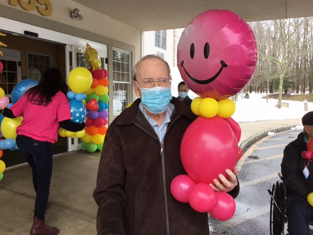 Male Senior Holds Gifted Balloon Buddy