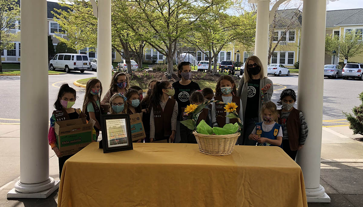Brownie Troops Visits with Cookies and Mask Chains for Seniors
